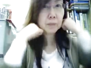 Mature Chinese lady teasing in office