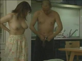 Cute Japanese babe with nice tits blows and gets nailed by dude with gun
