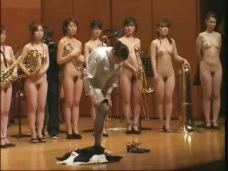 Weird Japanese oddity of a naked orchestra playing on stage
