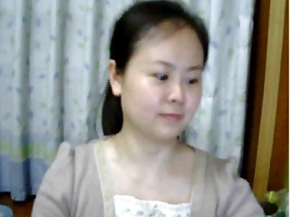 Plain looking Chinese lady flash her tits on webcam