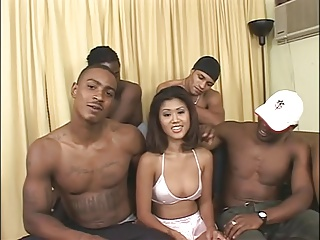 A Asian girl gets a interracial gangbang by black guys!